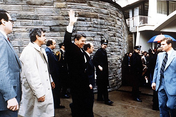 President Ronald Reagan Waves To Onlookers Moments Before  Hinckley Assassination Attempt