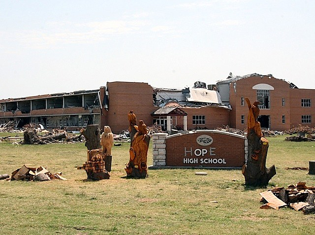 Joplin High School in Joplin, Mo., was destroyed by an EF-5 tornado that hit the city May 22. The letters on the sign were blown off in the storm and someone has since used tape to spell out the word 'hope' on the sign. (Photo by U.S. Army Photo/John Daves.)