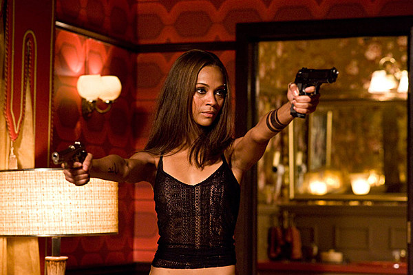 zoe saldana holding guns in the losers