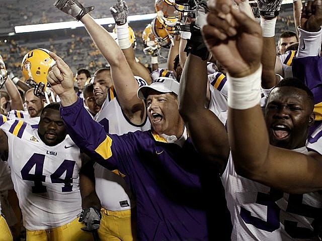 LSU and Les Miles celebrate their win over West Virginia.
