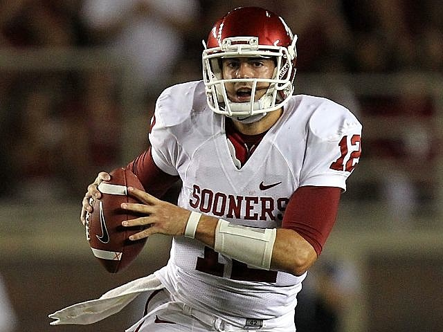 Oklahoma quarterback Landry Jones looks downfield.
