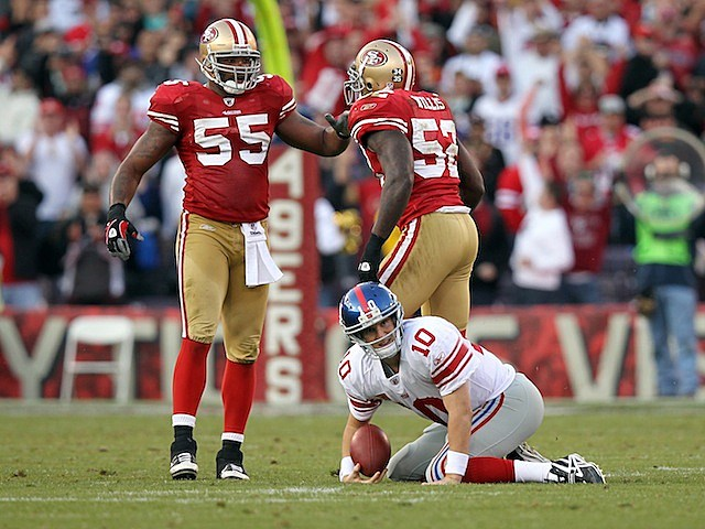 49ers celebrate over Eli Manning