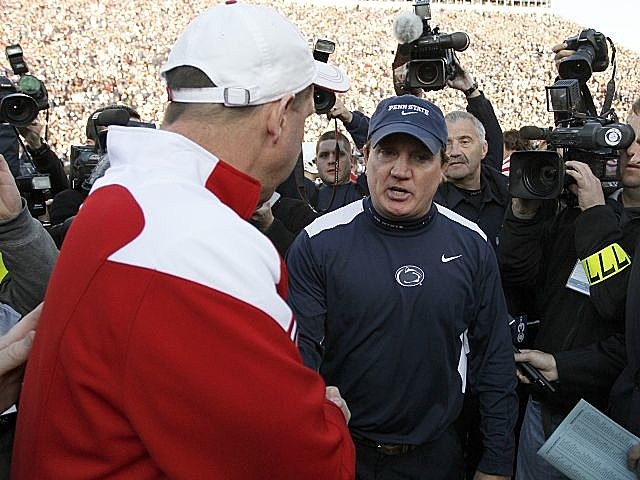 Penn State interim head coach Tom Bradley meets with Nebraska coach Bo Pelini after the Cornhuskers 17-14 win.