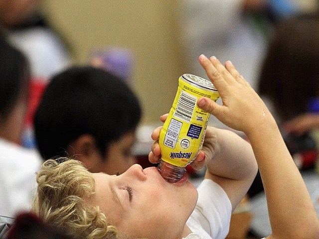 kid drinking chocolate milk