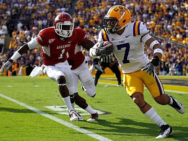 LSU's Tyrann Mathieu returns a punt against Arkansas.