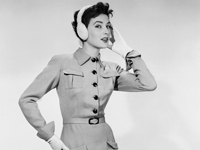 woman wearing vintage coat and ear muffs