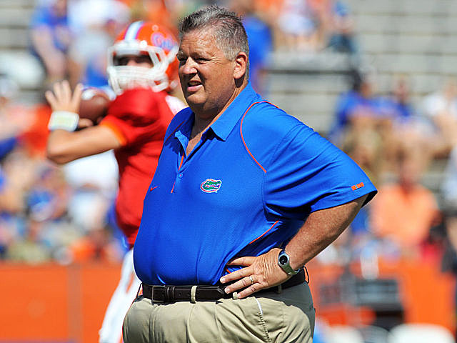 Charlie Weis hired as new head coach at Kansas.
