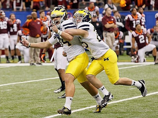 Michigan kicker Brendan Gibbons celebrates his game-winning field goal.