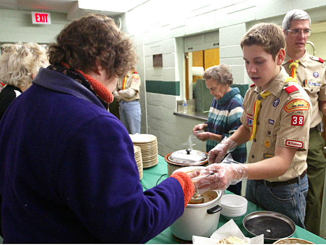 Illinois boy scout serving dinner