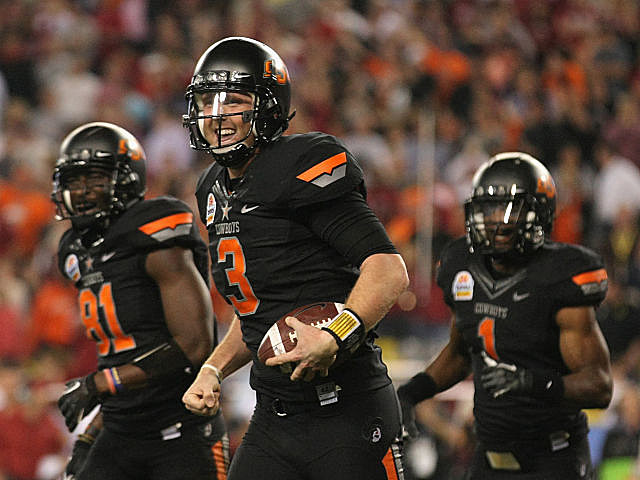 Oklahoma State players celebrate their first BCS win.