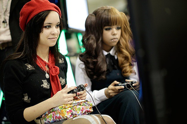 Manga And Anime Enthusiasts Take Part In The Hyper Japan Festival video game players controllers