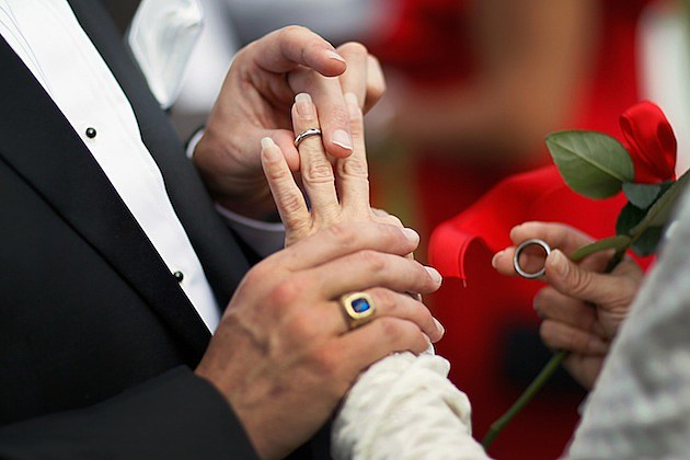 Group Wedding Held On Valentine's Day In West Palm Beach, Florida ring finger ceremony marriage husband and wife