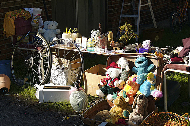 variety of items for sale at a garage sale