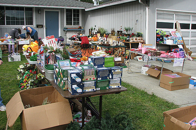 lots of different items for sale at a garage sale
