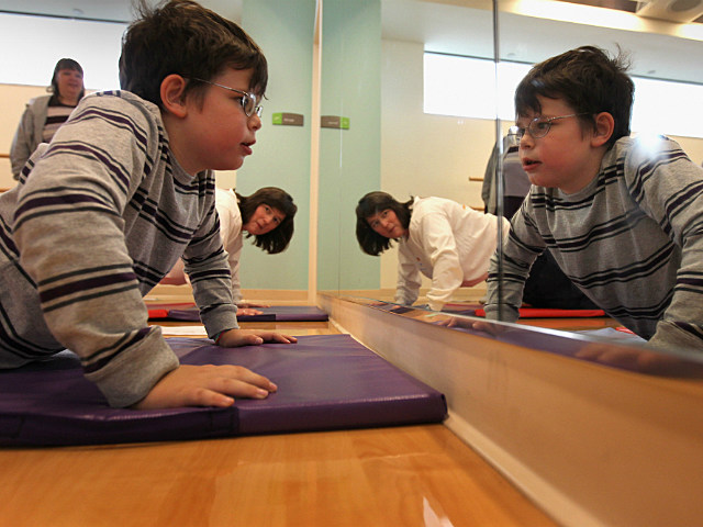 kid does push ups during exercise program