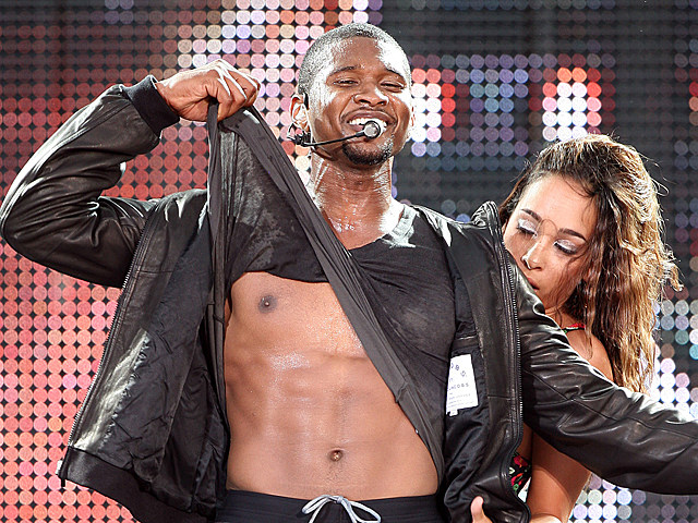 Usher strips at the 2008 NFL Kickoff