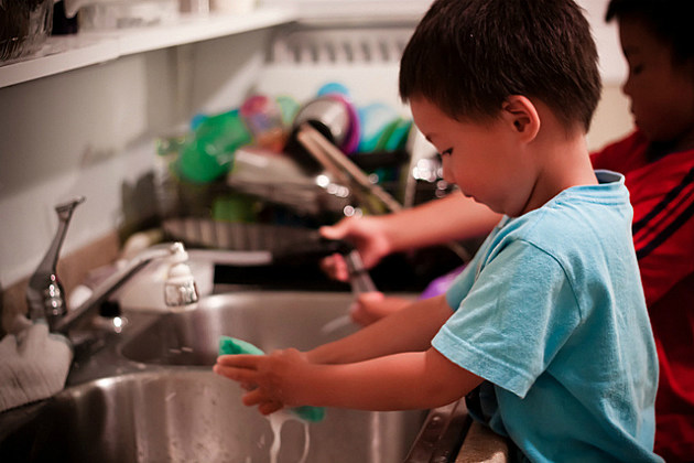 kids help get the dishes clean