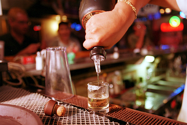 pouring a tequila shot in Mexico