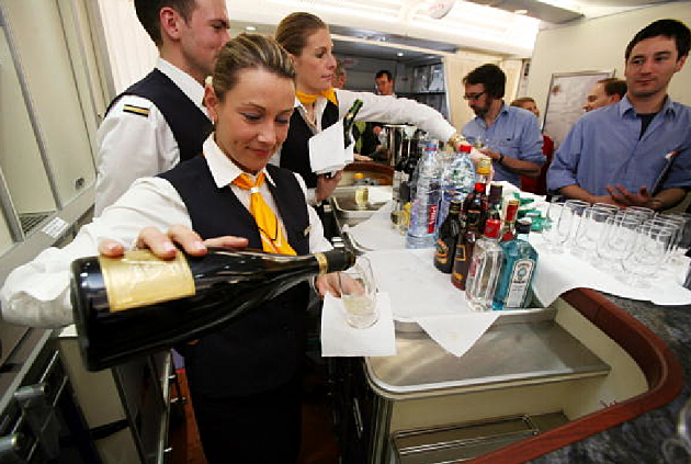 Alcohol being served on flight