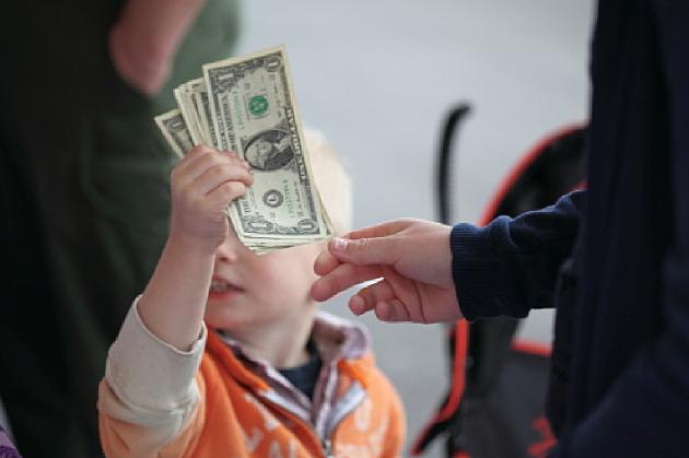 Boy holding money