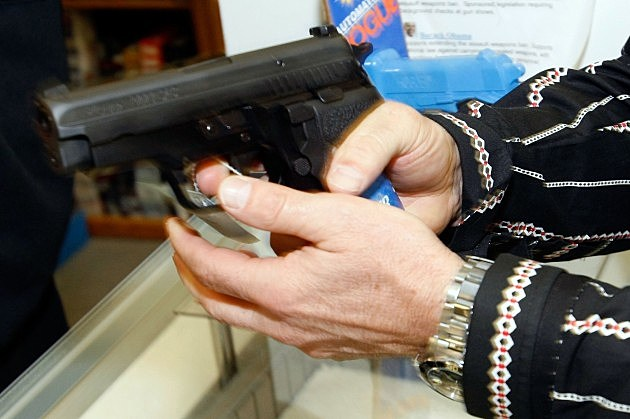 man checking out a gun at a retail gun shop