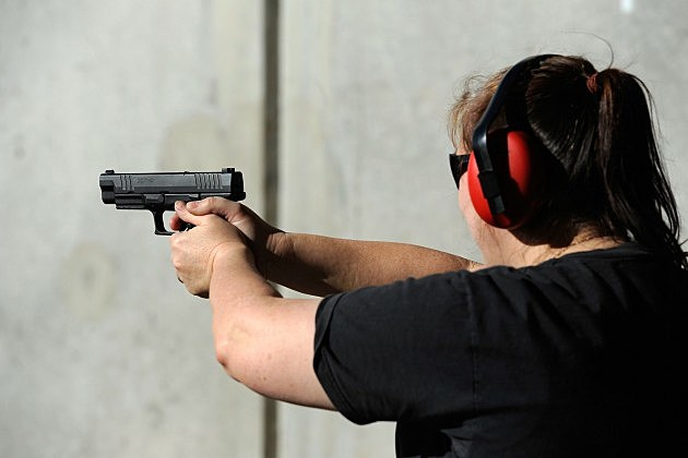 Woman at a gun range on January 15, 2011 in Tucson, Arizona.