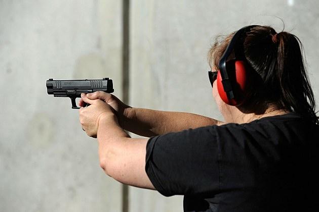 Woman at a gun range on January 15, 2011 in Tucson, Arizona.