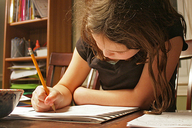little girl goes through her daily homework routine