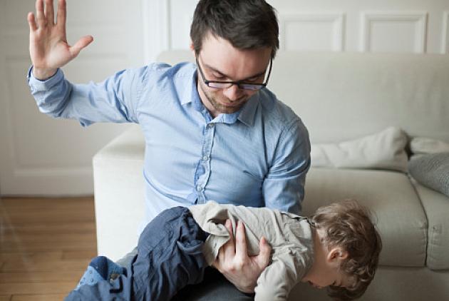 Dad spanking his son