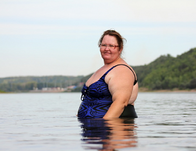 Overweight woman in a river