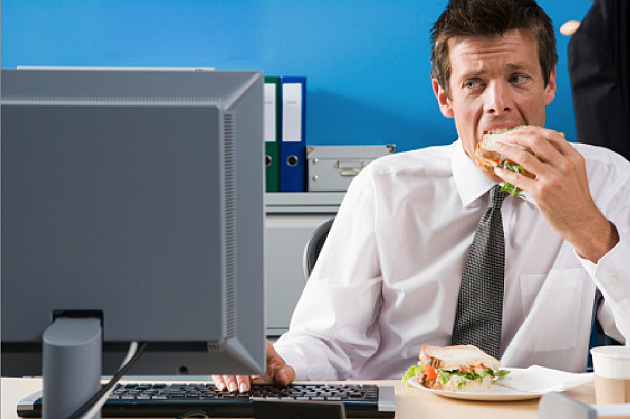 Man eating at his desk