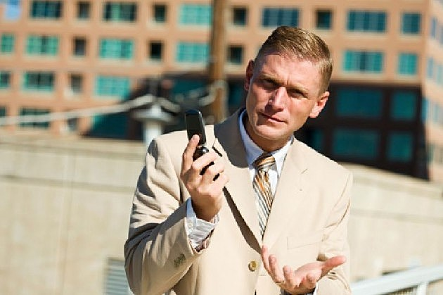 man having trouble with his cell phone