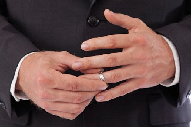 man playing with his wedding ring