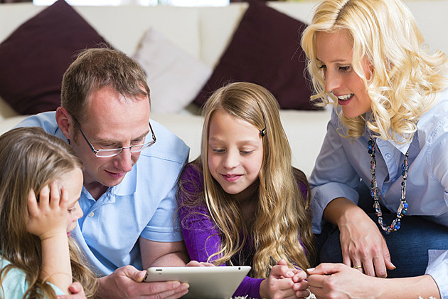 parents and children use tablet