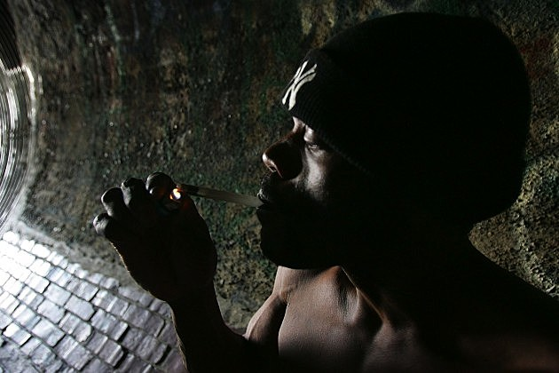 man smoking crack cocaine