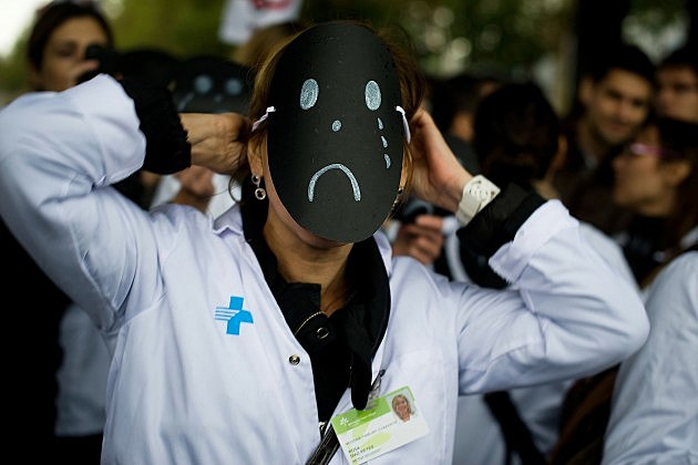 doctor wearing sad face mask