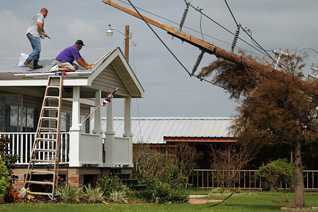 A roof being fixed after being damaged by Hurricane Isaac.