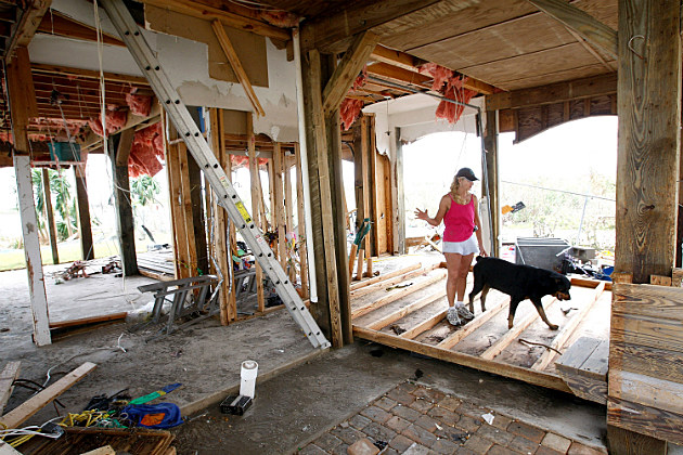 Resident surveys damage after Hurricane Ike hit Galveston, TX.
