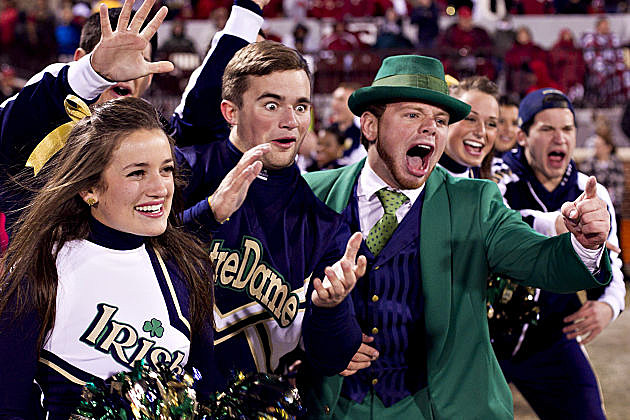 Notre Dame cheerleaders and fans celebrate the Irish victory over Oklahoma