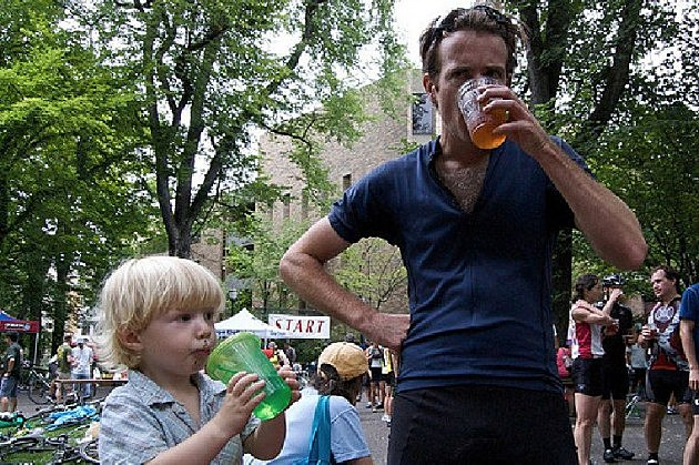 Dad drinking beer in front of his kid