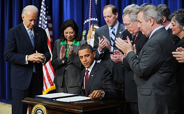 President Obama Signs The Middle-Class Tax Cut Bill