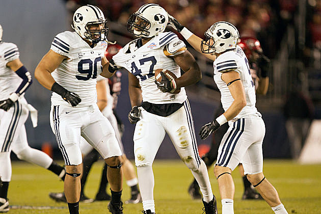 BYU defenders celebrate one of their four fourth quarter turnovers.