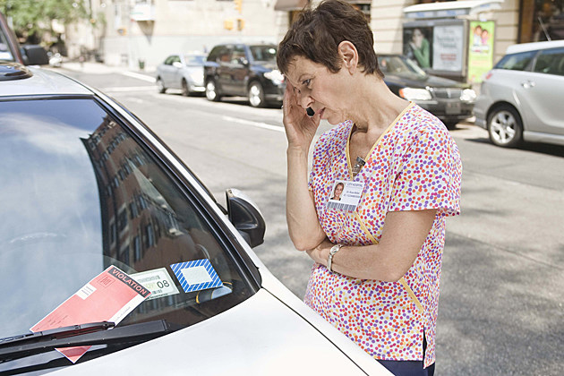 woman with parking ticket