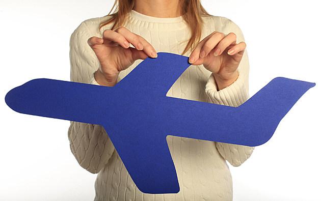 woman holding plane