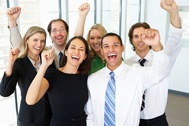 Group Celebrating in Office