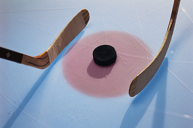 Ice Hockey Puck And Sticks In Faceoff - credit - Stockbyte - 78457119