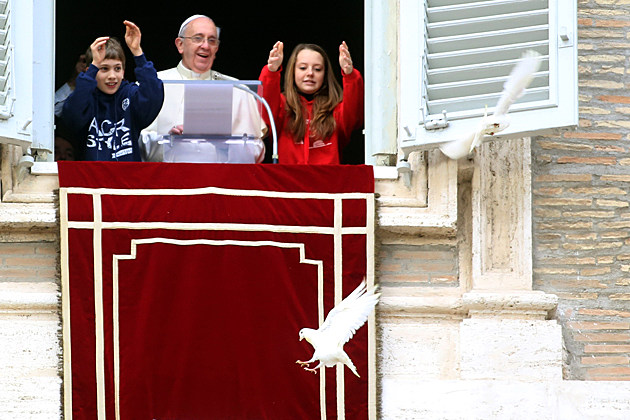 Pope Francis and two children release peace doves